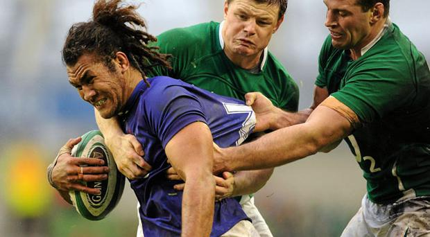 Brian O'Driscoll and Denis Leamy get to grips with Samoa's Manaia Salavea. Photo: Matt Browne / Sportsfile
