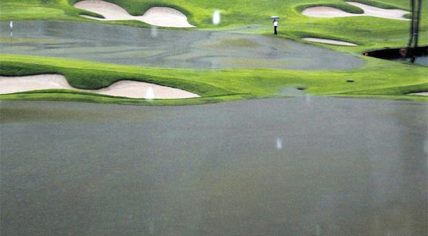 The flooded 18th green at the Sentosa Golf Club's following a bout of heavy rainfall which forced officials to postpone the final round of the Singapore Open.