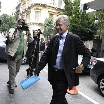 The International Monetary Fund's Gerry Rice enters the Greek Finance Ministry in Athens (AP)