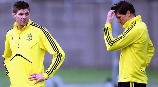 Fernando Torres and Steven Gerrard may have to soldier on for the rest of season without any new big-name signings to help them revive Liverpool's fortunes. Photo: Getty Images