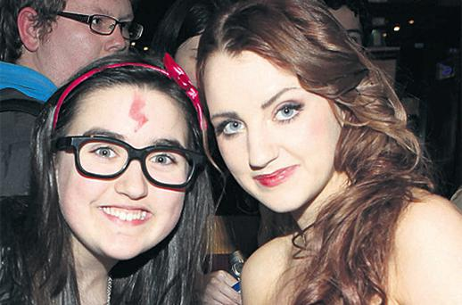 Irish actress Evanna Lynch, right, who plays Luna Lovegood in 'Harry Potter and the Deathly Hallows: Part 1', with fan Coley McManus (12), from Ballinteer, south Dublin, at the screening