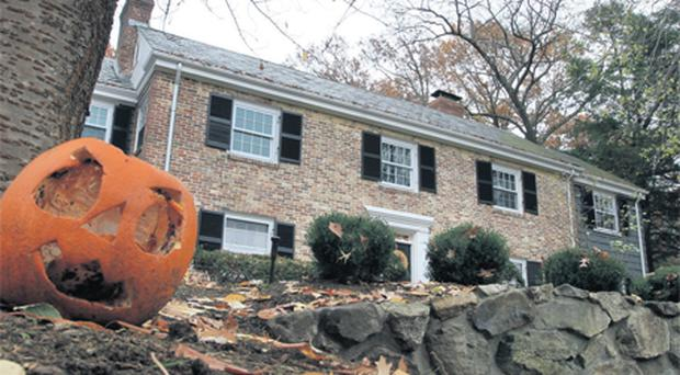 A decomposing halloween pumpkin outside the house owned by former Anglo Irish Bank chief executive David Drumm in Wellesley, Massachusetts, yesterday. Photo: AP