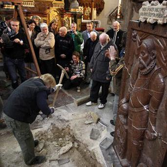 An archeologist opens the grave of Danish astronomer Tycho Brahe at the Church of Our Lady in Prague