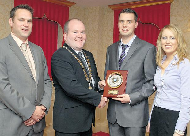Macra president Michael Gowing (second left) congratulates Macra's winning All-Ireland impromtu debating team of Evan Stanley (left), Kieran Foley and Aoife Connors