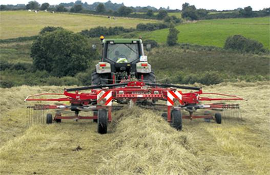 John O'Donovan and one of his workers show off the Lely 725 seven-metre rake