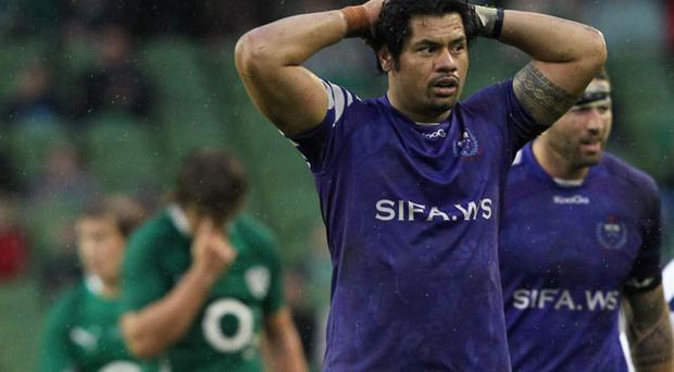 Samoa's George Stowers (2nd R) reacts after the final whistle against Ireland during a International rugby match at Aviva Stadium in Dublin, Ireland Novermber 13, 2010. Ireland beat Samoa 30-10