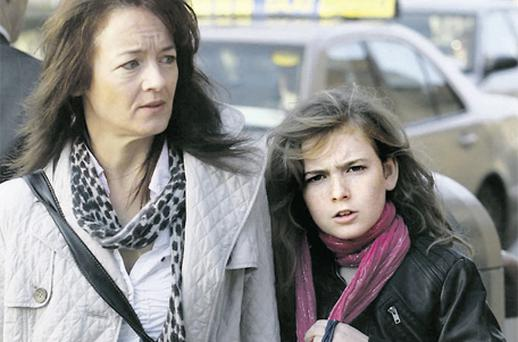 Ten-year-old Ellen Smith leaves Dublin Circuit Civil Court yesterday with her mother Irene
