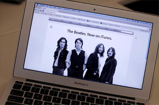 Apple changed its home page yesterday to celebrate the announcement that the Beatles' back catalogue would be available on iTunes
