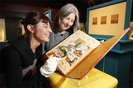 Paper conservator Gaia Petrella (left) and Dr Elaine Wright, curator of the 'Heroes and Kings of the Shahnama' exhibition