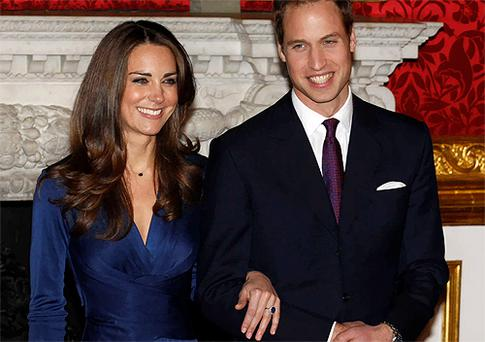 Prince William and his fiancee Kate Middleton pose for a photograph in St. James's Palace, London. Photo: Reuters