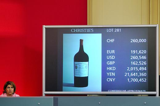 An imperial bottle of Chateau Cheval Blanc 1947 Bordeaux French wine is displayed on a screen during it's auction at a sale of fine wines by Christie's in Geneva