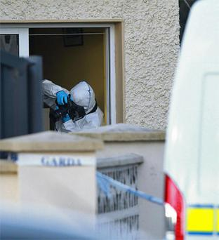 Garda forensics officers at the scene in Newcastle West. Photo: PA