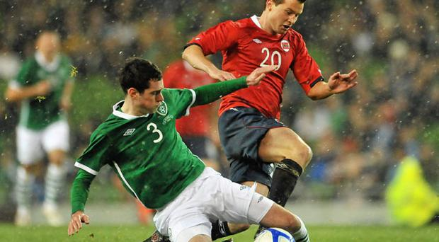Ireland's Greg Cunningham tackles Petter Vaagan Moen during their defeat to Norway at the Aviva Stadium last night.
