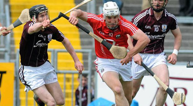 Cork's Fintan O'Leary and Galway's Niall Cahalan in action during the final round of this year's NHL fixtures. The game, which was effectively a dead rubber, was played out in front of a paltry crowd of 500.