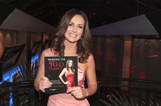 Lorraine Keane holds up a copy of her book. Photo: Collins Photo Agency