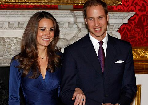 Prince William and his fiancee Kate Middleton pose for photographs in St. James's Palace, London shortly after announcing their engagement. Photo: Reuters
