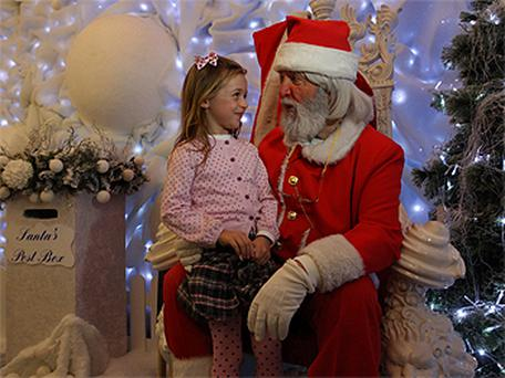 Santa who arrived at Arnotts Store speaks to Sarah Highland (6) from Trim. Photo: Collins