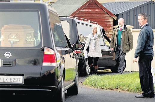 TERRIBLE TRAGEDY: State Pathologist Marie Cassidy leaves the house in Newcastle West, Co Limerick, where the killings took place. Photo: David Conachy