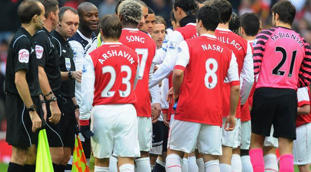 Arsenal and Tottenham players shake hands before the Barclays Premier League match between Arsenal and Tottenham Hotspur at the Emirates Stadium. Photo: Getty Images
