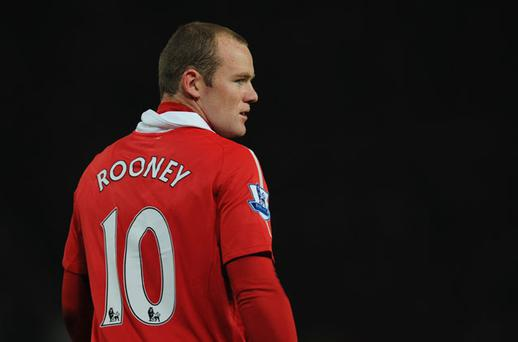 Wayne Rooney of Manchester United looks on during the Barclays Premier League match between Manchester United and Wigan Athletic at Old Trafford. Photo: Getty Images