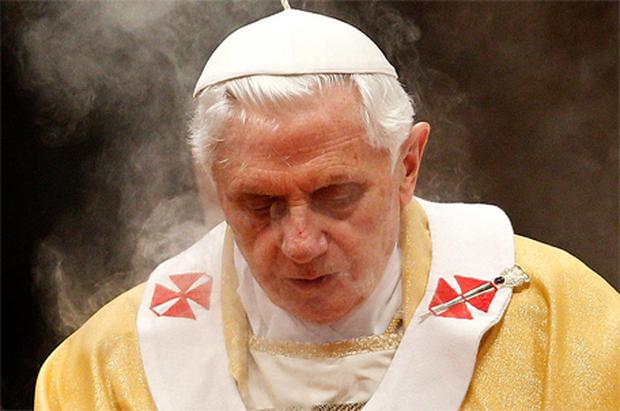 Pope Benedict praying at a ceremony in the Vatican yesterday