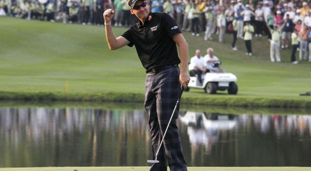 Ian Poulter celebrates after winning the Hong Kong Open yesterday. Photo: AP