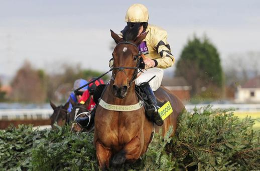 Frankie Figg and Brian Hughes on their way to victory at Aintree yesterday. Photo: PA