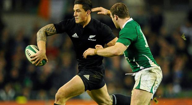 Sonny Bill Williams off-loads as Brian O'Driscoll tackles STEPHEN MCCARTHY
