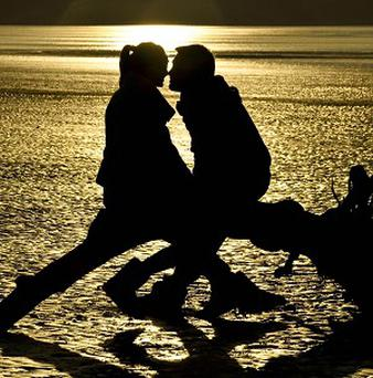 Couples make love more on a holiday than at home, a survey has found