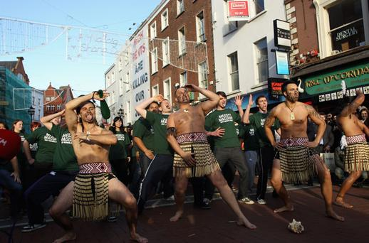 Members of the Ngati Ranana Maori Culture Group lead a mass Haka on Grafton Street in the city to build pre match atmosphere on November 19, 2010 in Dublin, Ireland.