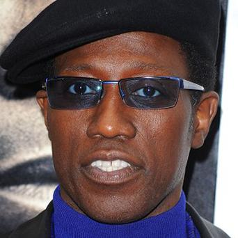 Actor Wesley Snipes has been ordered to start serving a three-year prison sentence after being convicted for tax-related crimes in 2008 (AP)