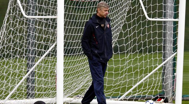 Arsenal manager Arsene Wenger during a training session at London Colney, Hertfordshire. Photo: PRESS ASSOCIATION