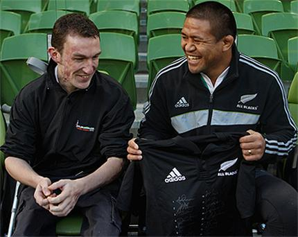 Keven Mealamu presents Kevin Mc Garry with a signed All Black jersey during the Captain's Run at Lansdowne Road