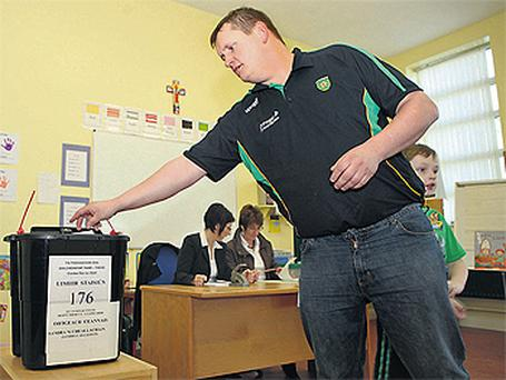 A voter casts his ballot on Arranmore Island yesterday in the Donegal South West by-election