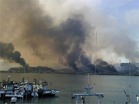 Smoke rises from South Korean Yeonpyeong Island after it was hit by dozens of artillery shells fired by North Korea. Photo: Reuters
