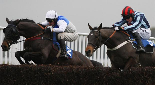 Barry Geraghty steers Shakalakaboomboom (R) to victory to complete a treble for Nicky Henderson at Kempton yesterday