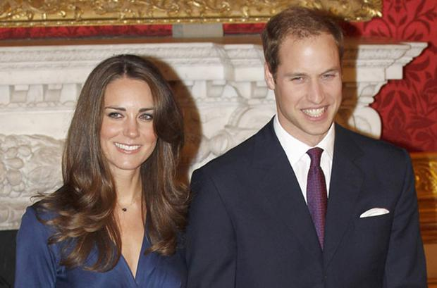 Britain's Prince William and his fiancee Kate Middleton pose for a photograph in St. James's Palace, in central London. Photo: REUTERS