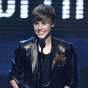 Justin Bieber accepts the award for pop/rock favourite male artist at the American Music Awards