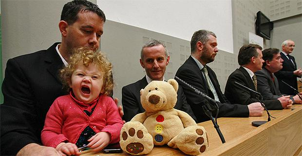 Daisy Gogarty (18 months) in the arms of Green Party TD Paul Gogarty as leader John Gormley (far right) gives a press conference calling for a general election. Photo: PA