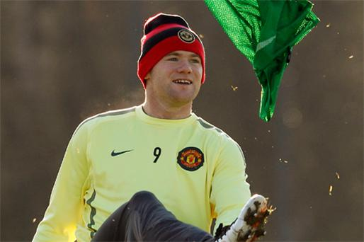 Wayne Rooney in playful mood during training yesterday ahead of Manchester United's match against Rangers tonight