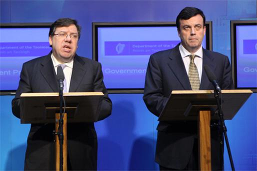 Taoiseach Brian Cowen and Finance Minister Brian Lenihan announce the bailout application on Sunday