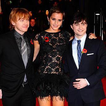 (Left to right) Rupert Grint, Emma Watson and Daniel Radcliffe arriving for the World Premiere of Harry Potter and The Deathly Hallows