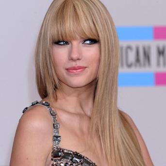Taylor Swift says she won't reveal who her songs are about