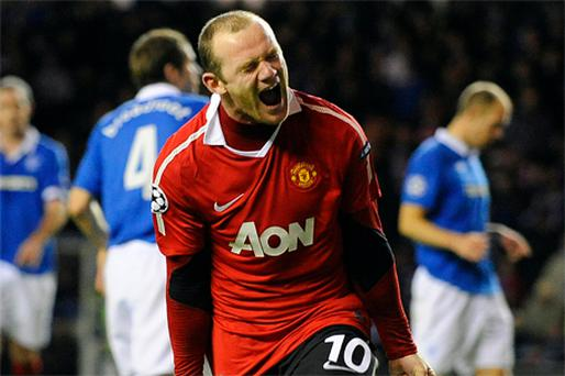 Wayne Rooney celebrates after scoring from the penalty spot for Manchester United at Ibrox last night