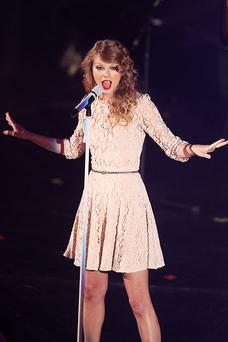 Taylor Swift onstage in lace. Photo: Getty Images