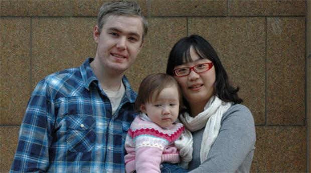 Patrick Chandler with his wife Fiona Zou and their daughter Rachel in China. Photo: Reuters