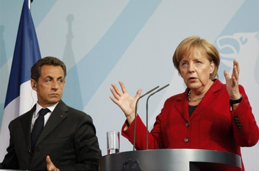 French President Nicolas Sarkozy and German chancellor Angela Merkel agreed that 'negotiations with the Irish Government must be brought to a speedy resolution'. Photo: Bloomberg News