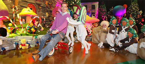 Tubridy tries out a tricycle with some of the children who will appear on the show. Photo: Collins
