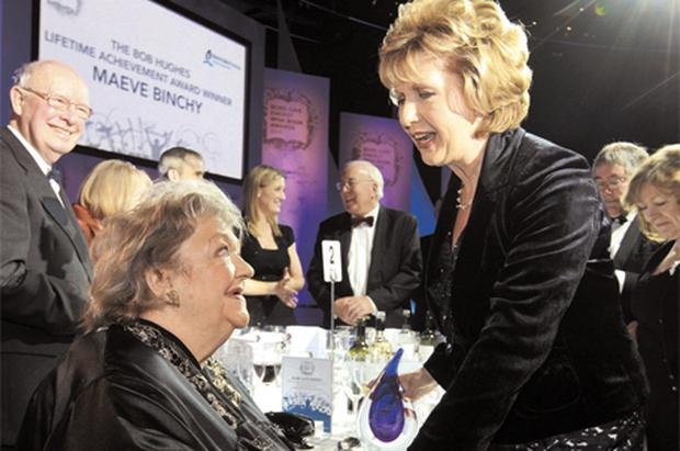 Author Maeve Binchy receives a Lifetime Achievement Award from President Mary McAleese at the Bord Gais Energy Irish Book Awards 2010, at the Mansion House, Dublin