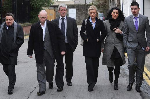 The family of the late Colette Donohoe (top left), from left: her brother Noel Moran, son Paul, husband Noel, daughter Jennifer; and her children's partners. The family attended a fitness-to-practise hearing into consultant surgeon Javaid Ahmad Butt at the Medical Council in Dublin yesterday. DAMIEN EAGERS